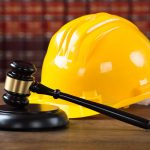 Personal Liability of Officers and Directors Under Ontario's Construction Legislation - Yellow hard hat and judge gavel
