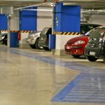 underground condo parking lot with cars
