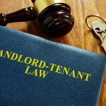 Landlord Tenant Law book with keys and gavel